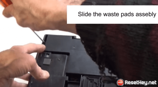 slide the waste pads asebly