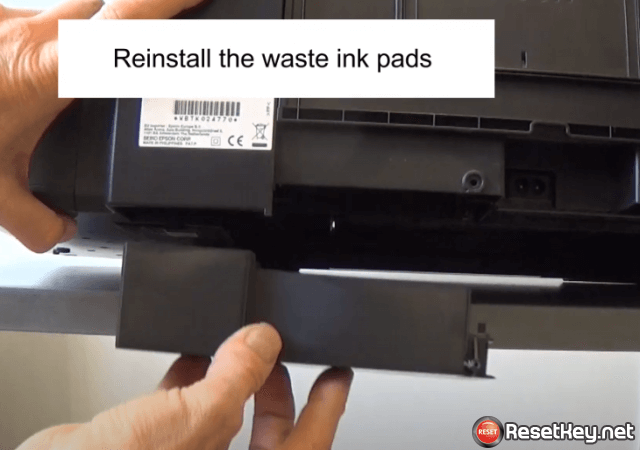 reinstall the waste ink pads into the printer
